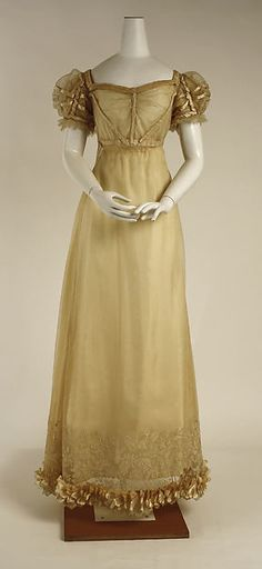 1820 ca. Light Gold Dress, British. Empire line, Silk, short puffed sleeves with trim, wide embroidered hem. metmuseum.org Credit: Irene Lewisohn Bequest, 1966.