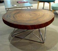 Mesa centro de diámetro 90 cm y alto 45 cm. Fabricada en acero inoxidable y tapa en sección tronco de madera.