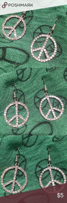 Rhinestone PEACE sign earrings Rhinestone Silvertone PEACE sign  earrings  and in excellent Preowned  condition. Peace sign earrings are the exact size of a quarter and are 1 inch long from where they connect. Jewelry Earrings