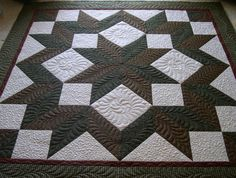 A Carpenter's Star Quilt Pattern, with beautiful FMQ, by Deonn.   Pattern is  available for purchase at Craftsy.