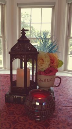 Ramadan decorations. Candles to create the warm glow and a mug - a personal favorite as a coffeeholic. And flowers to give a pop of color. The Koran is also featured.