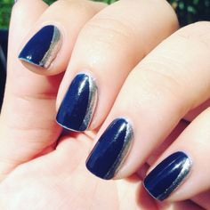 A cute side French mani using a navy blue and silver. For added contrast, you could use a matte top coat over the blue only and leave the silver glossy.