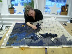 Rag rug - Cross stitch tee-shirt on canvas.