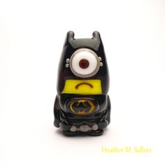 Batman Minion, a lampwork glass bead by Heather Sellers.  #batman #minion #lampwork #bead