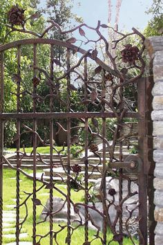 Wrought iron gate with rose detailing - from http://www.alfordsenglishgardens.com