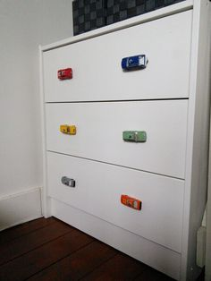 My diy, i replaced the boring knobs with toy cars for our toddler boy! Would luv to know how she did this