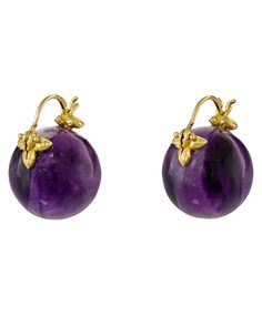 these Gabrielle Sanchez earrings are smooth globes of saturated purple amethyst