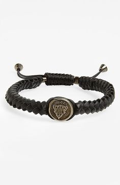 Free shipping and returns on Gucci 'Crest' Woven Leather Bracelet at Nordstrom.com. An embossed sterling silver crest centers a handsome bracelet made from braided strips of leather and fitted with an adjustable cord.