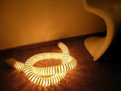 Artemide Boalum - světelný had. Udělá atmosféru v obýváku a tak.