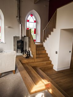 Timber stairs between split levels and framing the new wood-burning stove at Foolow Chapel - James Darwent Architecture. Chapel Conversion, Church Conversions, Exterior Design, Interior And Exterior, Timber Stair, Self Build Houses, Cottage Renovation, Old Churches, Transformers