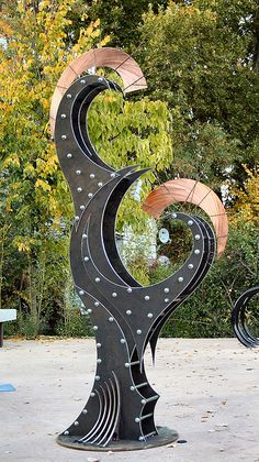 """Flux"" reclaimed steel  copper; stands 8 feet tall.  See in person at Legacy Park, McCall Id."