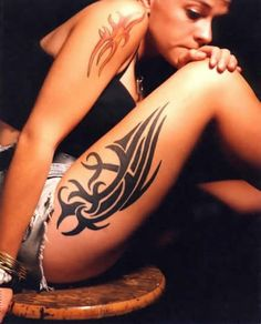 So want this thigh tribal tattoo...WILL HAVE