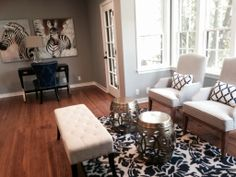 This office/sitting room was an unusual shape, so I created separate areas for work and conversation. The navy/cream/gold color palette ties in well with the gray/cream/gold palette of the living and dining rooms.