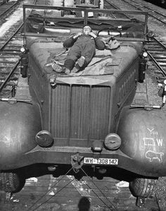 A Famo SdKfz 9 heavy 18 ton halftrack with it's driver napping on the hood while being transported by ordinance train
