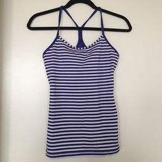 """Power Y tank in Royal blue & white stripes In beautiful condition (no pilling or snags); however, slightly shorter than my other Power Y tanks (this one is 23"""" from shoulder to hem), so unfortunately I must part ways with it--just a preference thing since I have a short waist to begin with!  Luon material. No trades. lululemon athletica Tops Tank Tops"""