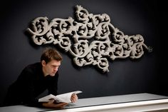 HEATWAVE - Joris Laarman Lab.  Wall mounted electric heating unit. Made of concrete, aluminum, and epoxy.