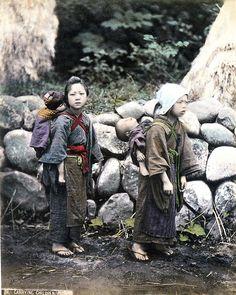 "Description: Description: ""Carrying Children"". Late 19th century Japanese hand tinted print.    Date: c.1900?"