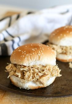 Easy hot crockpot shredded chicken sandwiches, an Ohio classic recipe, made with stovetop stuffing! Shredded chicken sandwiches made in the crockpot using stovetop stuffing and Ritz crackers. This shredded chicken sandwich recipe feeds a crowd! Shredded Chicken Sandwiches, Shredded Chicken Recipes, Chicken Parmesan Recipes, Slow Cooker Shredded Chicken, Ritz Crackers, Slow Cooker Recipes, Crockpot Recipes, Cooking Recipes, Slow Cooking