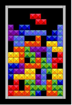 Tetris quilt.   As much as I LOVE to play tetris, I should have this quilt wrapped around me while doing so!