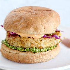 Recipe for Spicy Cauliflower Burgers with avocado sauce, cilantro lime slaw, and chipotle mayo! Meatless, filling, and delicious! Cauliflower Burger, Spicy Cauliflower, Vegetarian Recipes With Cauliflower, Vegetarian Dish, Vegan Foods, Vegan Dishes, Healthy Snacks, Healthy Eating, Healthy Recipes