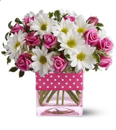 absolutely love the pink and white flowers with the pink and white polka dot ribbon!