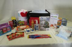 "Car Emergency Kit - The best selling auction baskets are ones that are practical, so that the person bidding on it is getting something they NEED.  This ""Emergency Car Kit"" includes first aid supplies, blanket, ponchos, flashlights and more!"
