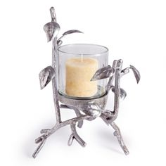 Glimmering silver branches create an elegant nest for a simple glass hurricane. An eye-catching accent for any room!