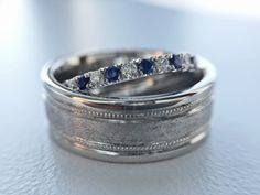 Wedding bands!  His and hers!  Artsy and unique.  #IDo #WithThisRing #Sapphires…