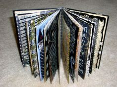 Altered book journal by ingriddijkers.  Click to see her gallery of individual pages using white lettering & lots of dark backgrounds.  Striking <3