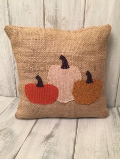 Add some rustic charm to your fall decor. This sweet pumkin trio pillow would look great on a bench, your couch or a chair! This pillow is made from recycled burlap and sweaters. Each pumpkin is hand                                                                                                                                                       More