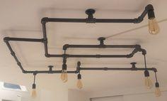 Kronleuchter in Eisenrohr für 6 Lampen