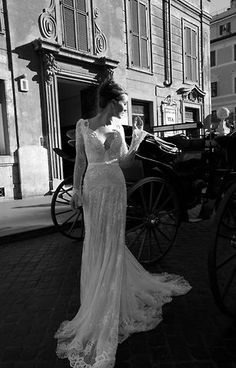 The lace wedding gown  I like how it hugs the hips but is also cinched at the waist