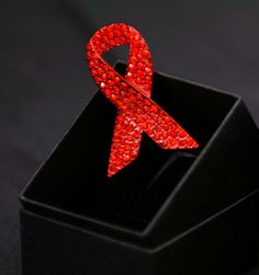 The red ribbon, a symbol of awareness and support for those living with HIV/AIDS. (National AIDS Trust)