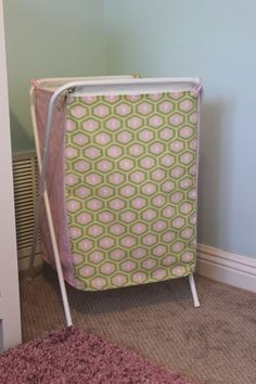 laundry bag make-over.......FYI >> you can also make a laundry bag holder out of an old tv tray stand!