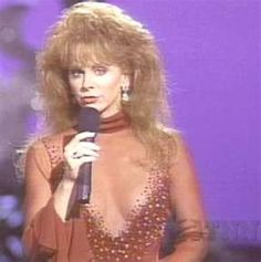 Reba this is the dress she wore backwards at an awards show. She did not realize it till after the show ended.