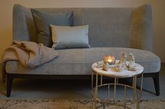 Dragonfly sofa, FEM Home Must Have cushions, Sunday Afternoon plaid, Riviere table with Champagne finish! All available at Galli Interiors Studio