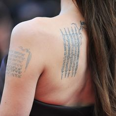 Celebrities with Tattoos: Angelina Jolie Actress Angelina Jolie has tattoos on her lower back, forearm, shoulder blade, neck, shoulder, wrist, and hip. Our favorite is the one on her left shoulder blade, a magical Pali incantation written in Khmer, the native language of Cambodia. She got it to protect her and son Maddox from bad luck and accidents.  celebrity ink | celebrity tattoos | back tattoo | arm tattoo | bicep tattoo | incantation tattoo | tattoo ideas | tattoo inspiration