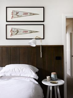 Master bedroom details – Vintage Aspen ski flags, Lean lamp from Great Dane furniture,and Jardan Olba marble top table. Photo – Eve Wilson, production – Lucy Feagins / The Design Files. Beadboard Wainscoting, Wainscoting Nursery, Dining Room Wainscoting, Wainscoting Ideas, Hecker Guthrie, Contemporary Cabin, Dining Nook, The Design Files, Mudroom
