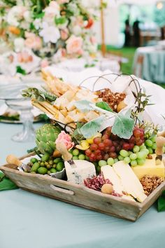 A flowing cheese platter is hearty and festive and encourages guests to eat and enjoy.