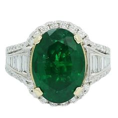 Oval 7.25 Carat Emerald and Baguette Diamond White Gold Engagement Ring