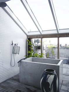 attic bath with glass ceiling