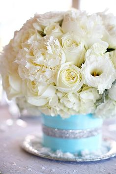 White Floral (roses & peonies) table arrangement in a Tiffany blue base. bouquet, wedding themes, white flowers, low centerpieces, tiffany blue, table arrangements, wedding table centerpieces, floral arrangements, blue weddings