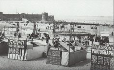 ca. 1887, New Brighton beach with photo-tents and waterside swing-sets
