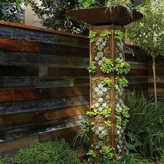 Vertical garden tower - Favorite DIY Garden Projects - Sunset - good for water collection? Jardim Vertical Diy, Vertical Garden Diy, Vertical Gardens, Vertical Planting, Small Space Gardening, Small Gardens, Outdoor Gardens, Tower Garden, Garden Art