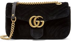 Gucci - Gg Marmont Small Velvet Shoulder Bag - Black ucci updates its 'Marmont' bag in plush velvet that's quilted with signature chevron stripes. This small version has a burnished gold 'GG' plaque at the center and opens to a silk-lined interior that will hold your cell phone, keys and cardholder. The sliding chain allows you to wear it multiple ways - carry it in-hand to showcase the embroidered heart at the back.