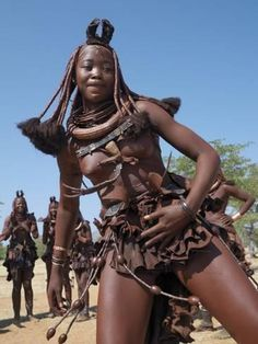 Himba Women Perform the Otjiunda Dance, Stamping, Clapping and Chanting Fotoprint van Nigel Pavitt bij AllPosters.nl