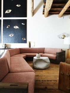 pink sofa in room with ceiling beams