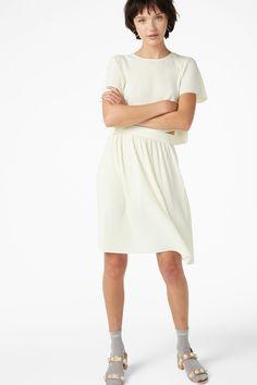 Model front image of Monki pleated mini skirt in white