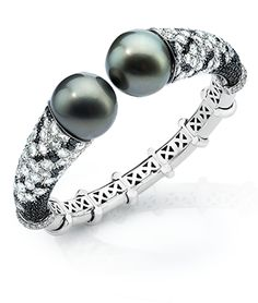 Cellini Jewelers Tahitian Pearl Bangle Tahitian black pearls accented with rose-cut and brilliant white and black diamonds. Set in white gold. Jewelry Bracelets, Jewelery, Pearl Bracelets, Pearl Necklace, Modern Jewelry, Fine Jewelry, Black Pearl Jewelry, Lotus Jewelry, Jewelry Editorial