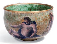 JEAN MAYODON (1893-1967) COUPELLE, VERS 1960 En céramique émaillée vert et rouge jaspé or, à décor central d'un nu féminin chevauchant un triton, le bord doré débordant Hauteur : 3,5 cm. (1 3/8 in.) ; Diamètre : 16,3 cm. (6 3/8 in.) Monogrammée M et située SEVRES à l'or au revers